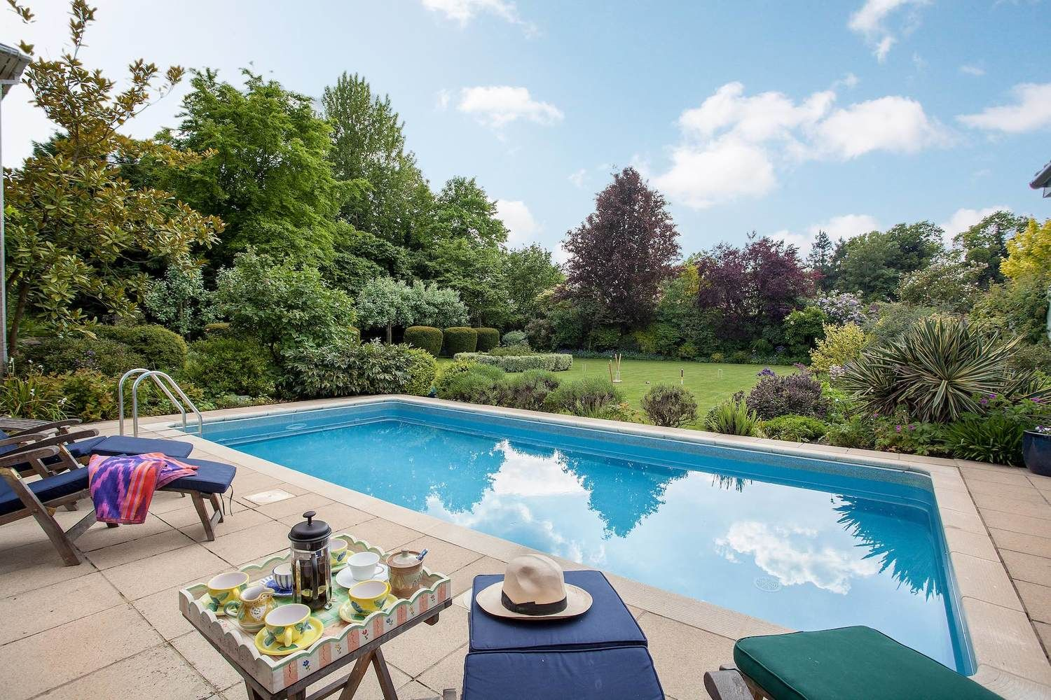 Heated swimming pool with views across the Walled Garden