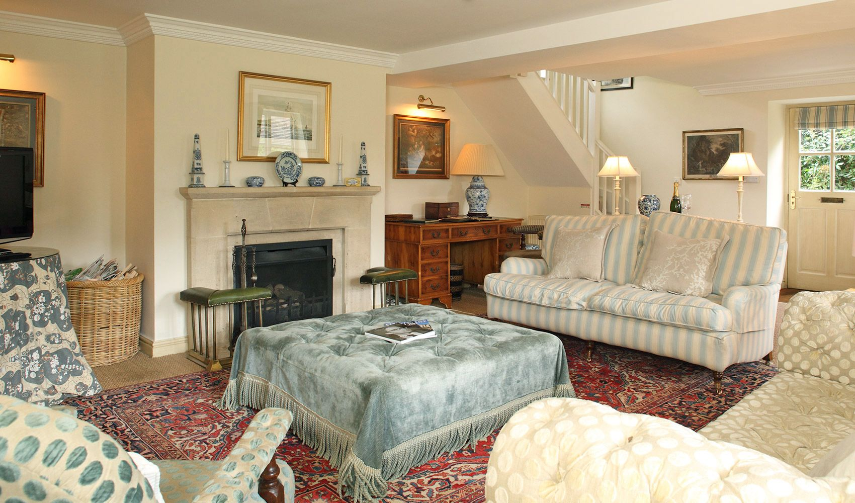 Ground floor: Peaceful and light drawing room with a large open fireplace