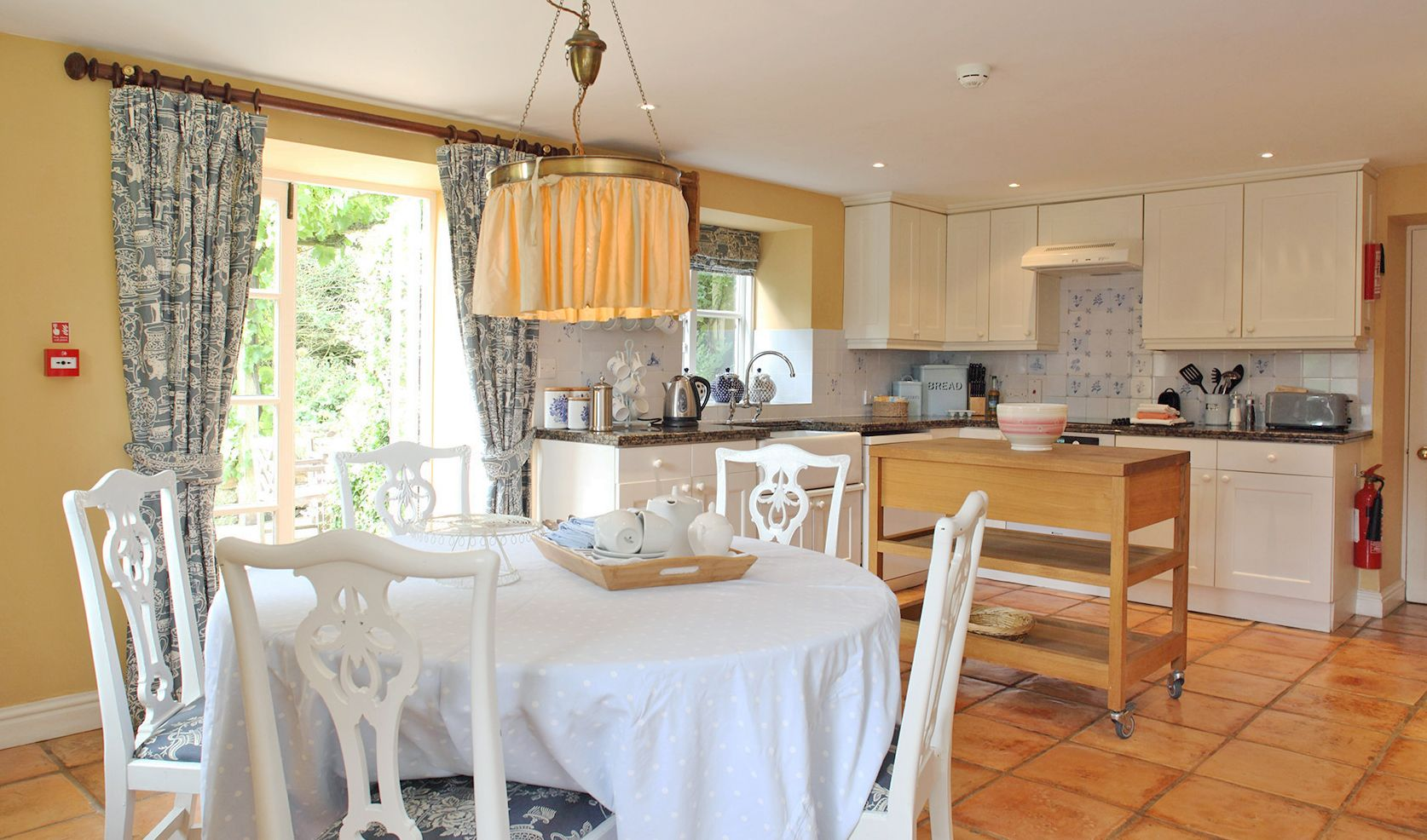 Ground floor: Well equipped kitchen/dining room with French doors onto the terrace