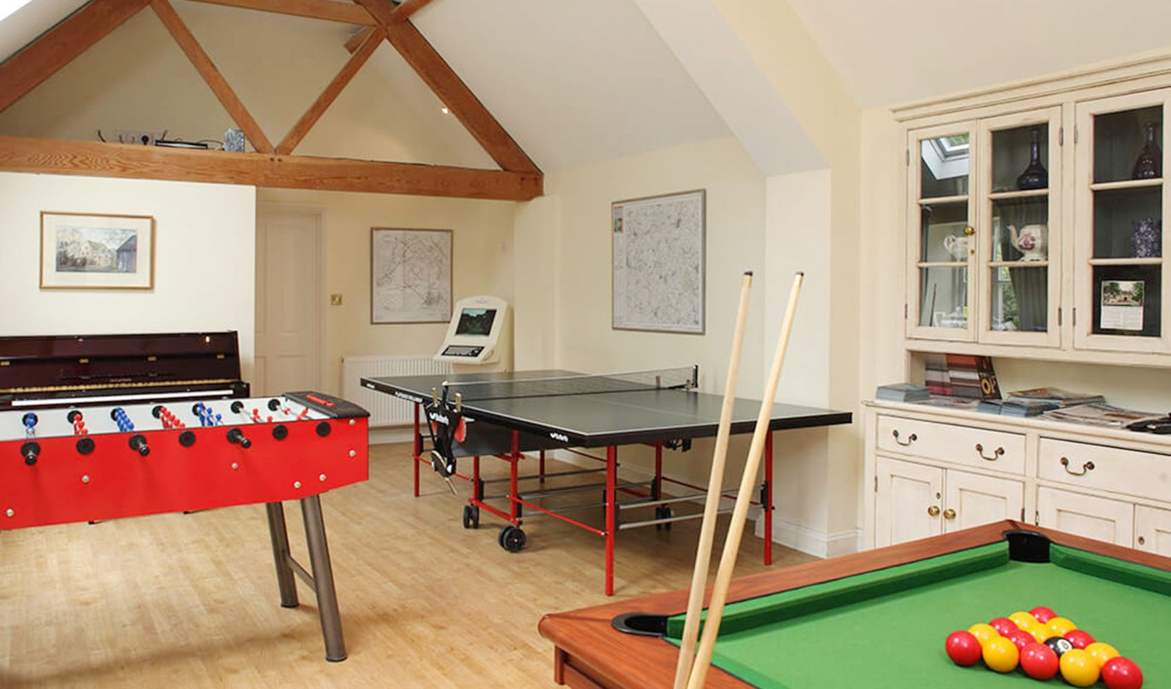 Shared games room with DVDs, table tennis, pool table, football table & a TV