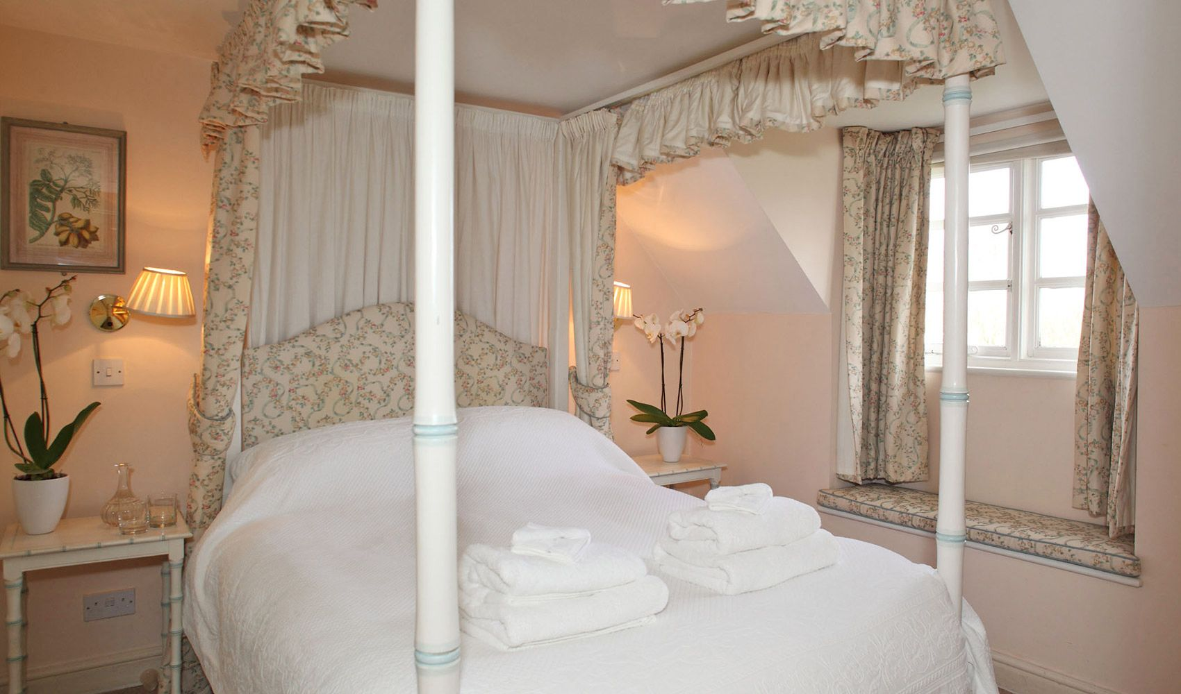 Second floor: Master bedroom with a faux bamboo four-poster bed