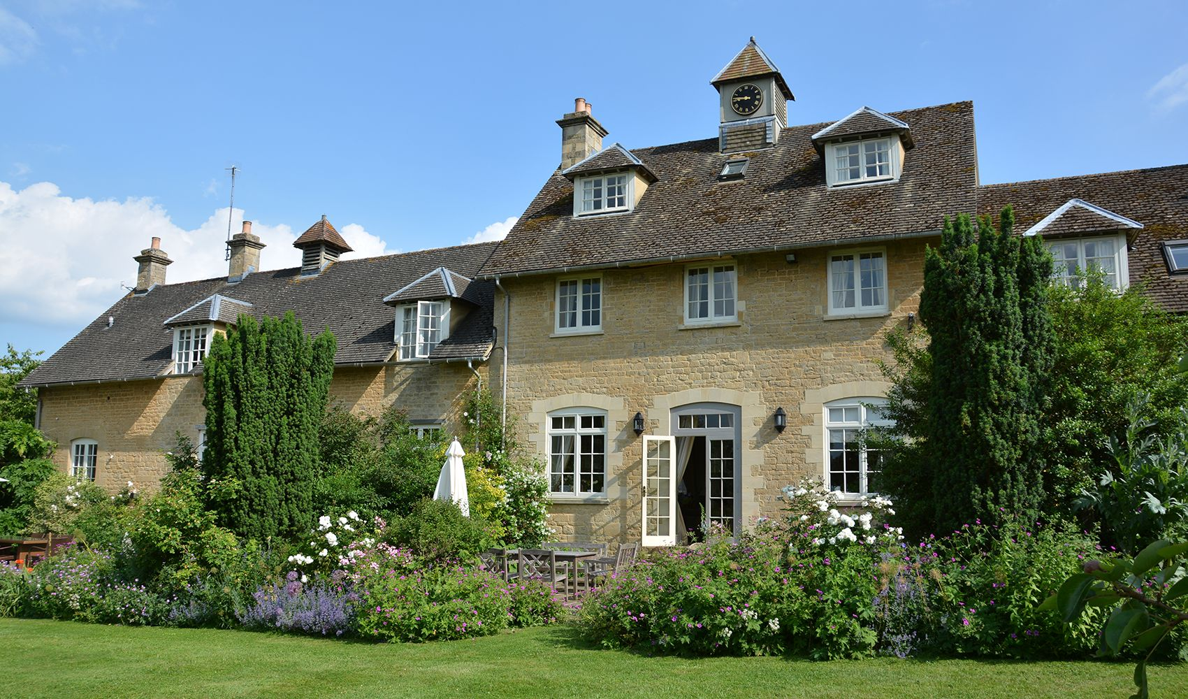 Rear view of Cheltenham Cottage, located above Sandown Cottage in the centre of the courtyard