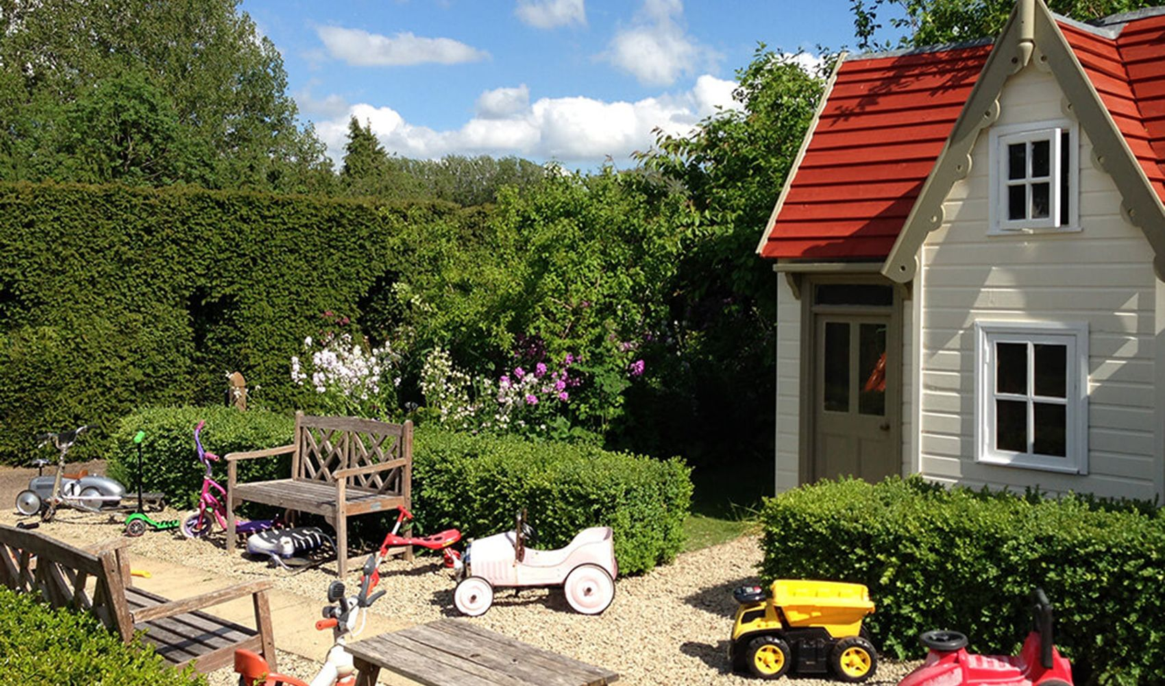 Shared walled garden with elegant two-storey wendy house