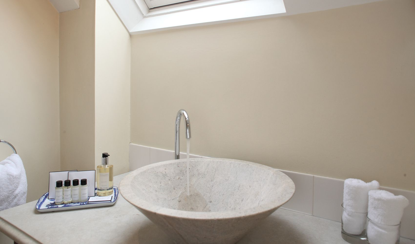 First floor: En suite bathroom with power shower over the bath & conical limestone basin