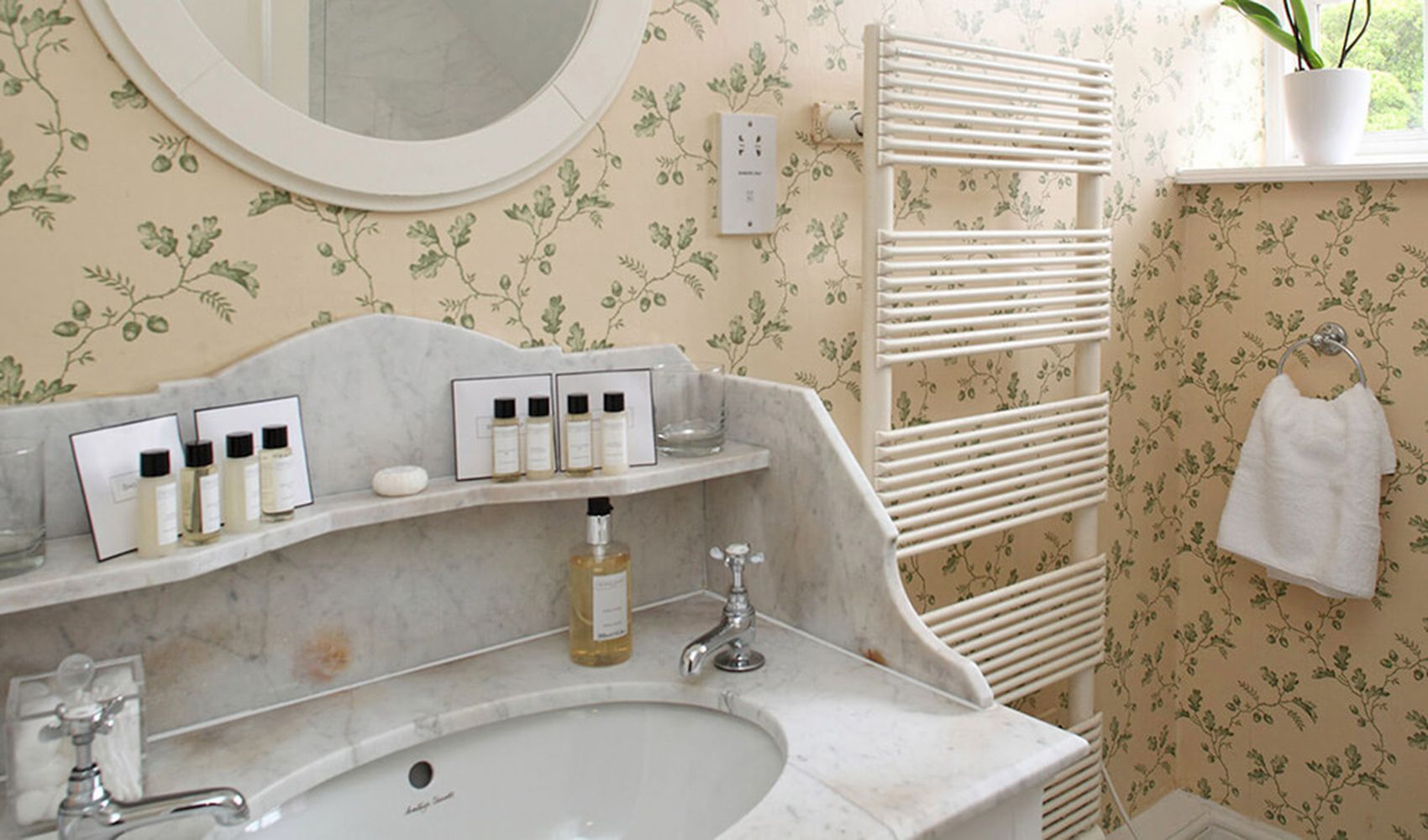 First floor: Family bathroom with marble topped washstand & bath with power shower