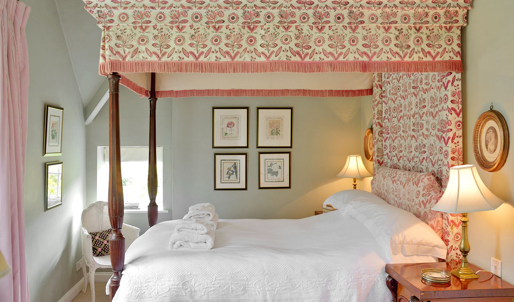 First floor: Double bedroom with a four poster bed and an en suite shower room