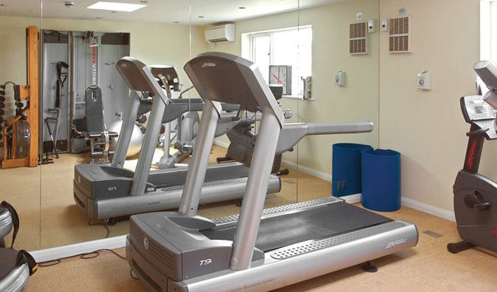 Fully equipped gym with running treadmills, bike, giant TV screen & the Power Plate