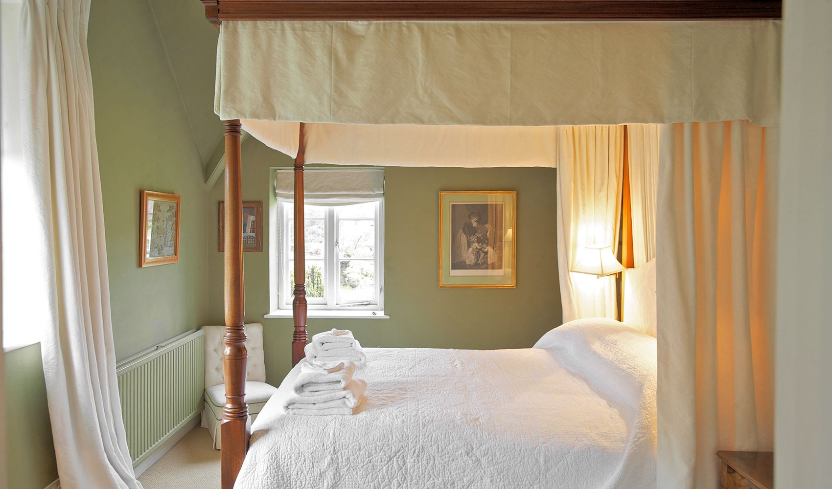 First floor: Large master bedroom with a four poster bed & en suite shower room