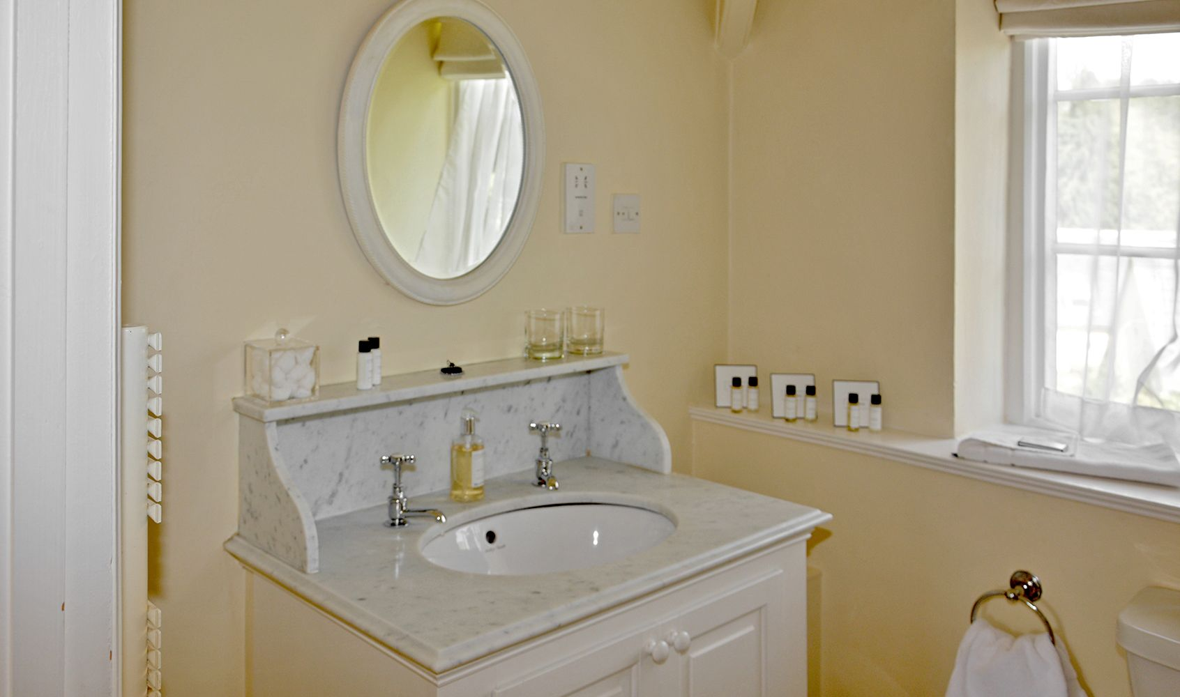 First floor: Family bathroom with washstand & bath with power shower over
