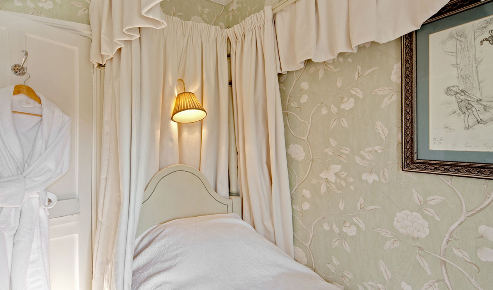First floor: Single bedroom with a faux bamboo four poster single bed