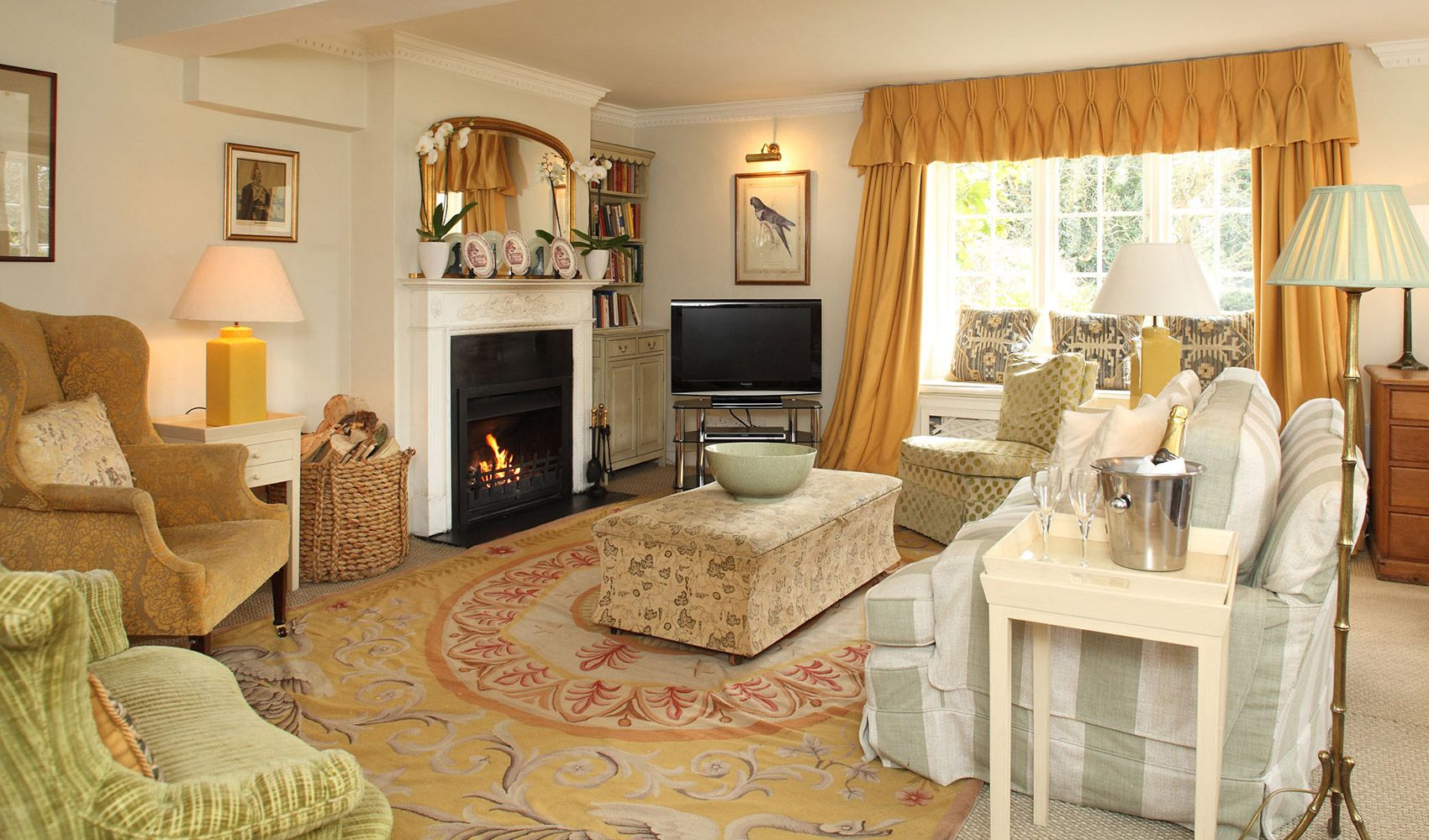 Ground floor: Inviting drawing room with a circular dining table & an open fire