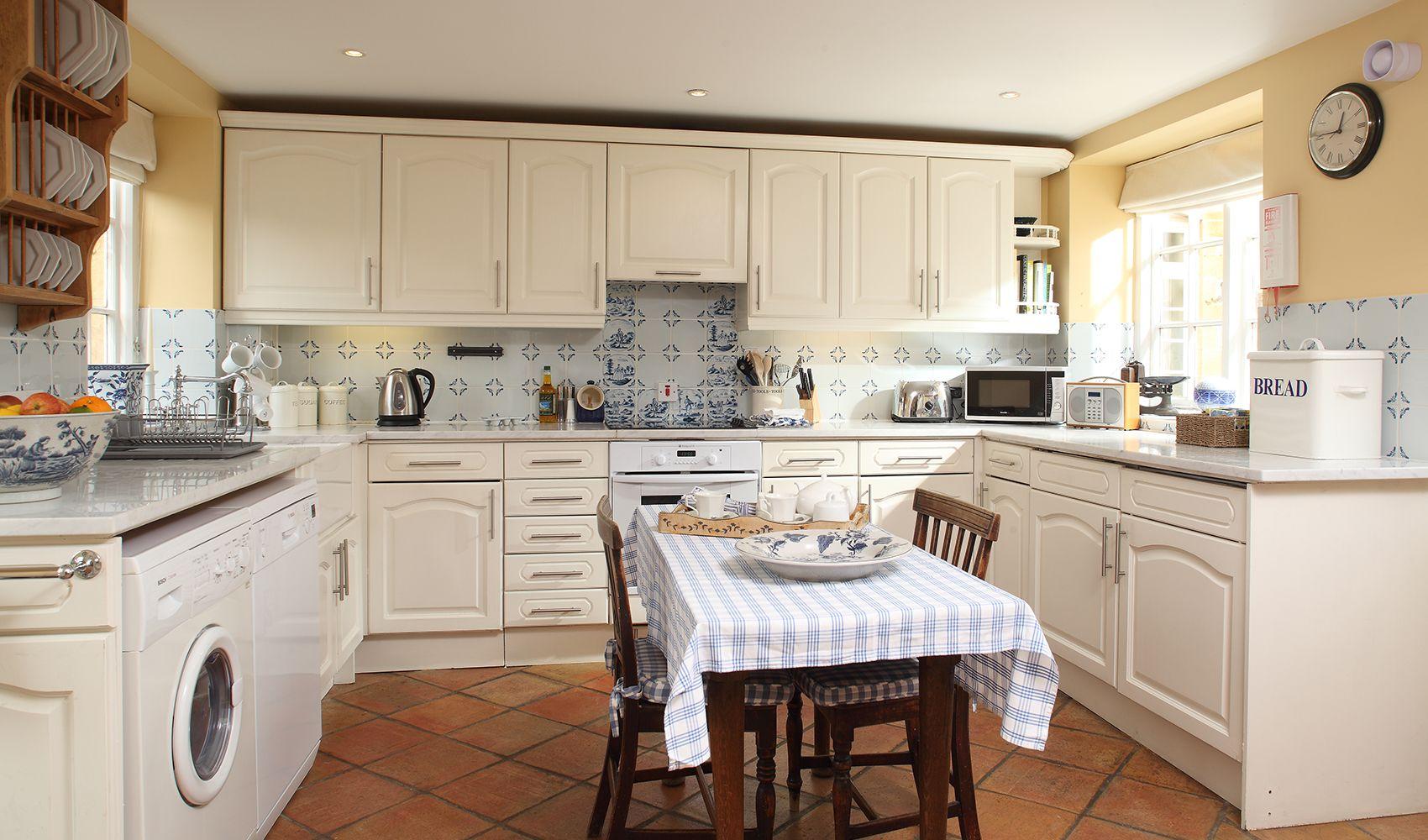 Ground floor: Kitchen area with door onto the terrace & private garden