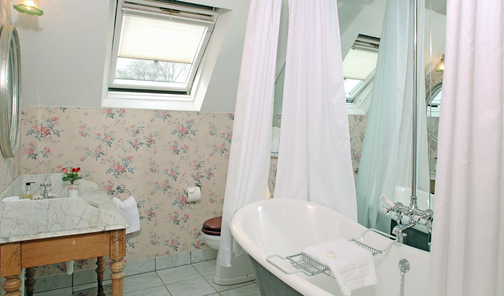 First floor: En suite bathroom with marble-topped washstand