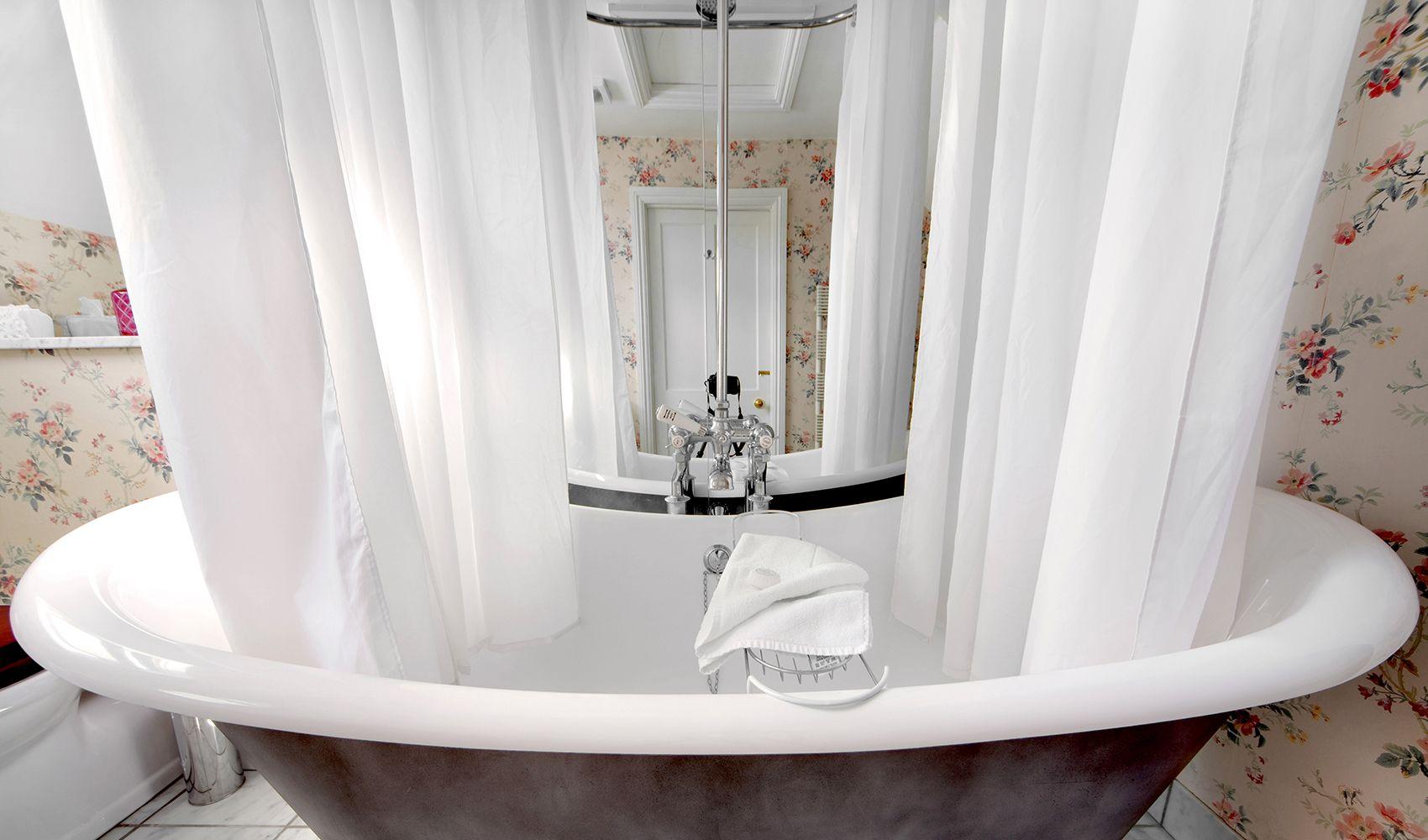 First floor: En suite bathroom with handsome bateau bath