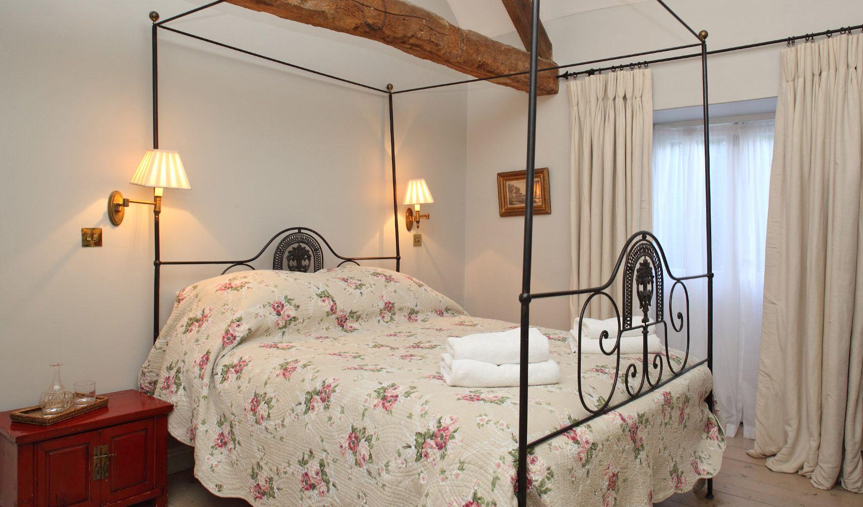 Master bedroom with doors to the garden and en suite bathroom