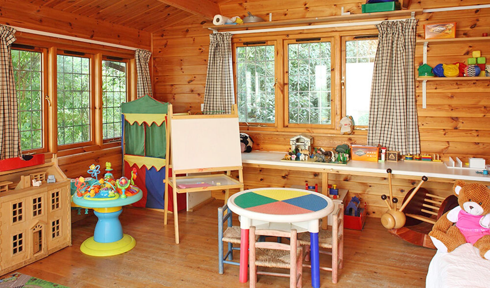 Shared heated play cabin with dressing up gear, toys & arts materials