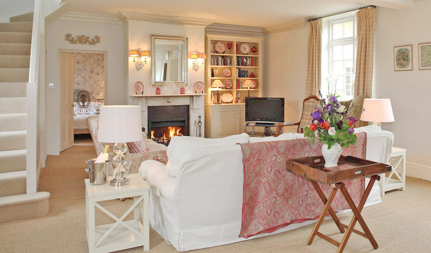 Ground floor: Enormous open plan drawing/dining room/kitchen with an open fire