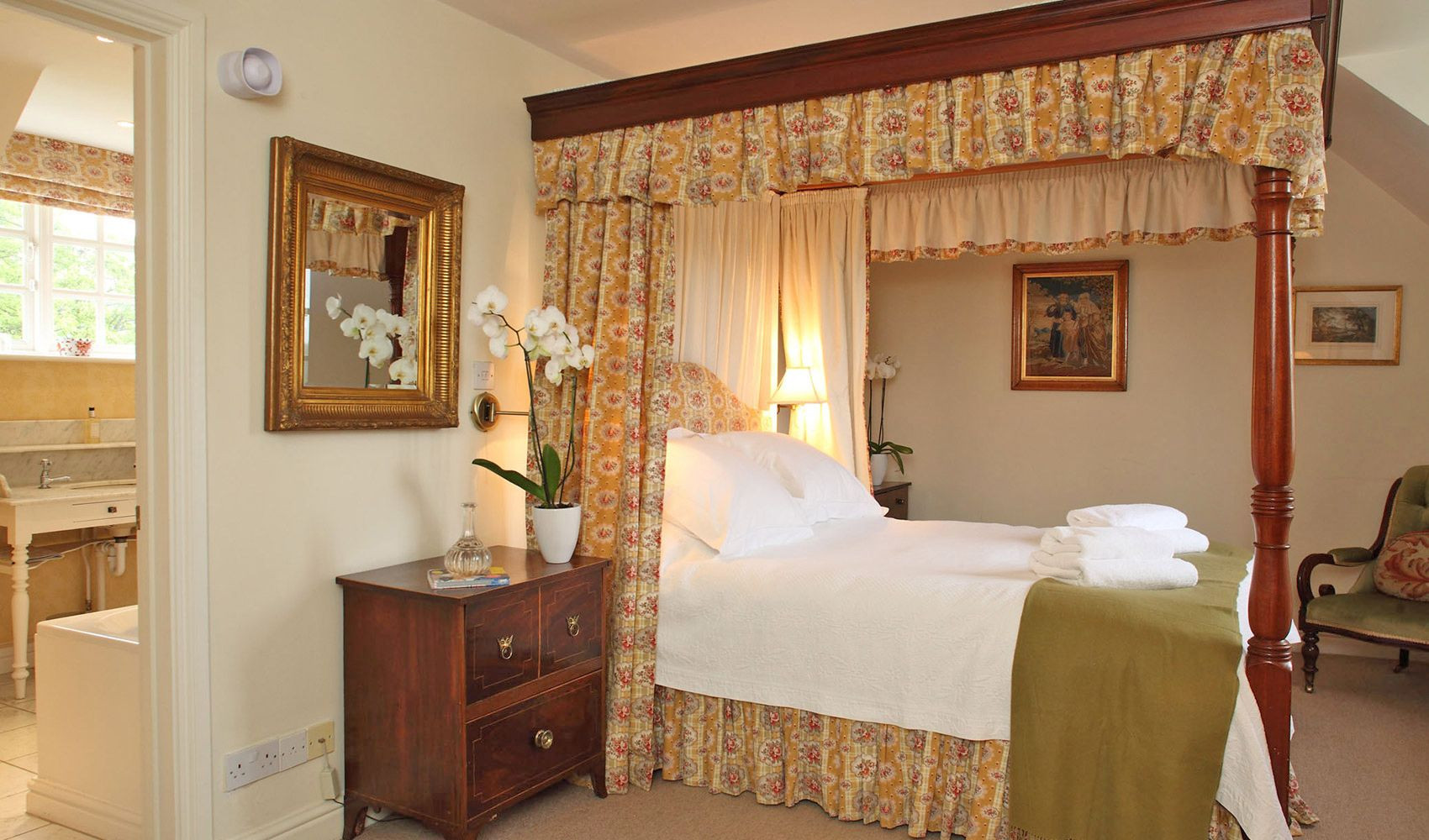 First floor: Master bedroom with a four poster bed & en suite bathroom