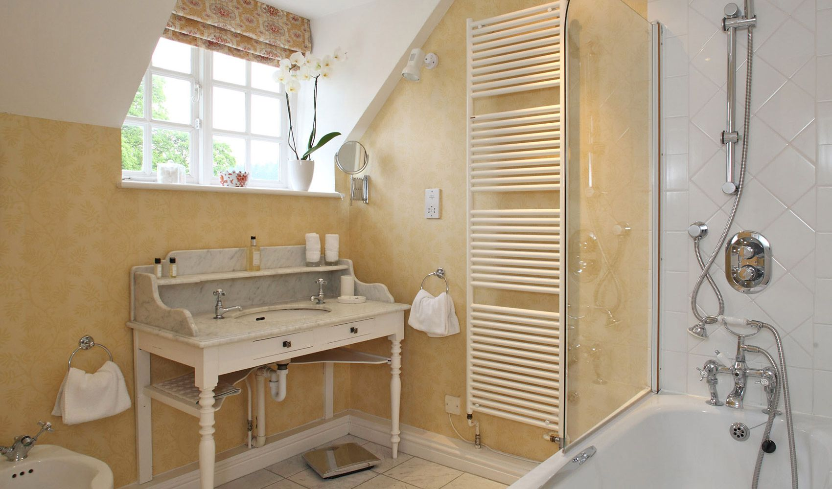 First floor: En suite bathroom to master bedroom with shower over the bath