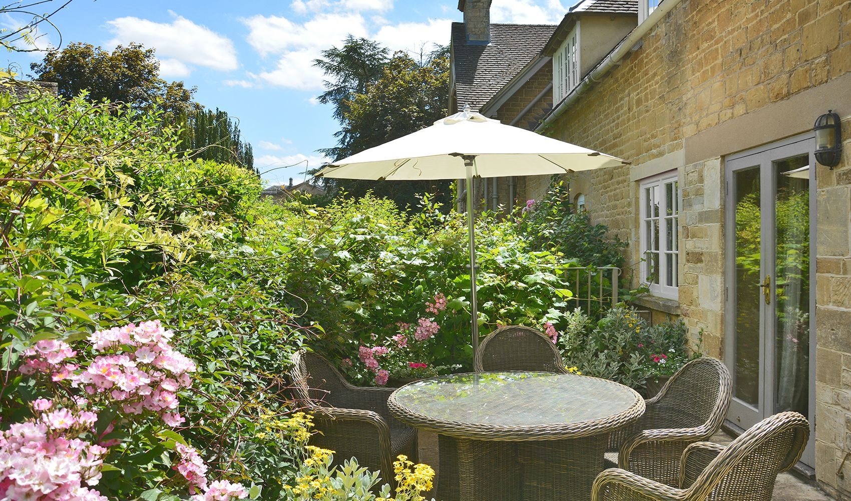 Private terrace overlooking the wisteria alley with garden furniture & BBQ