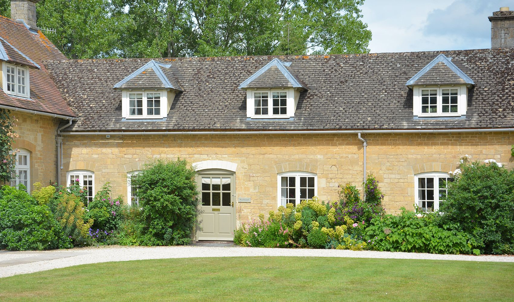 Wychwood Cottage, sleeping 4, is on the right-hand side of Bruern's courtyard