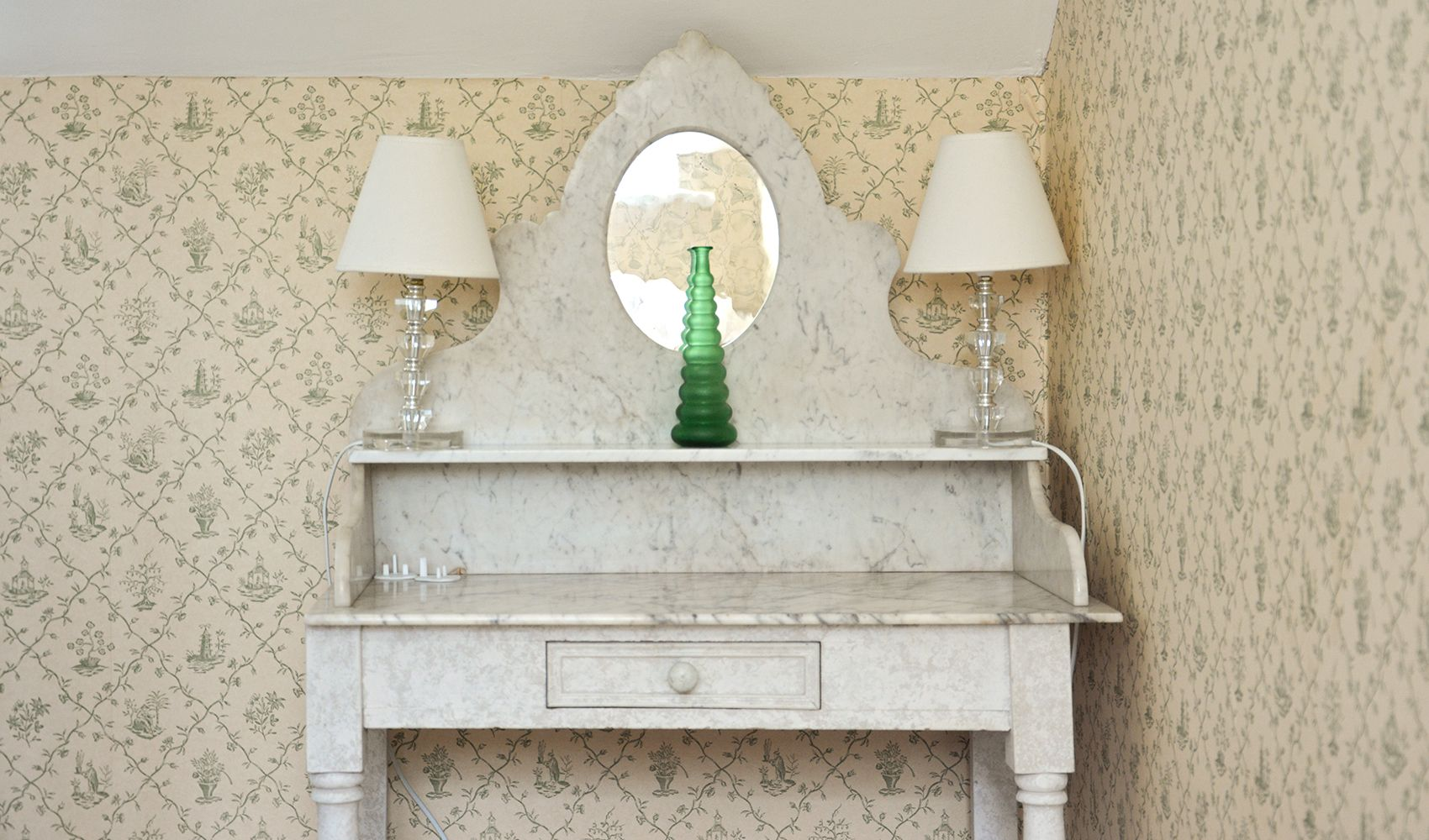 First floor: Little marble-topped dressing table in the double bedroom