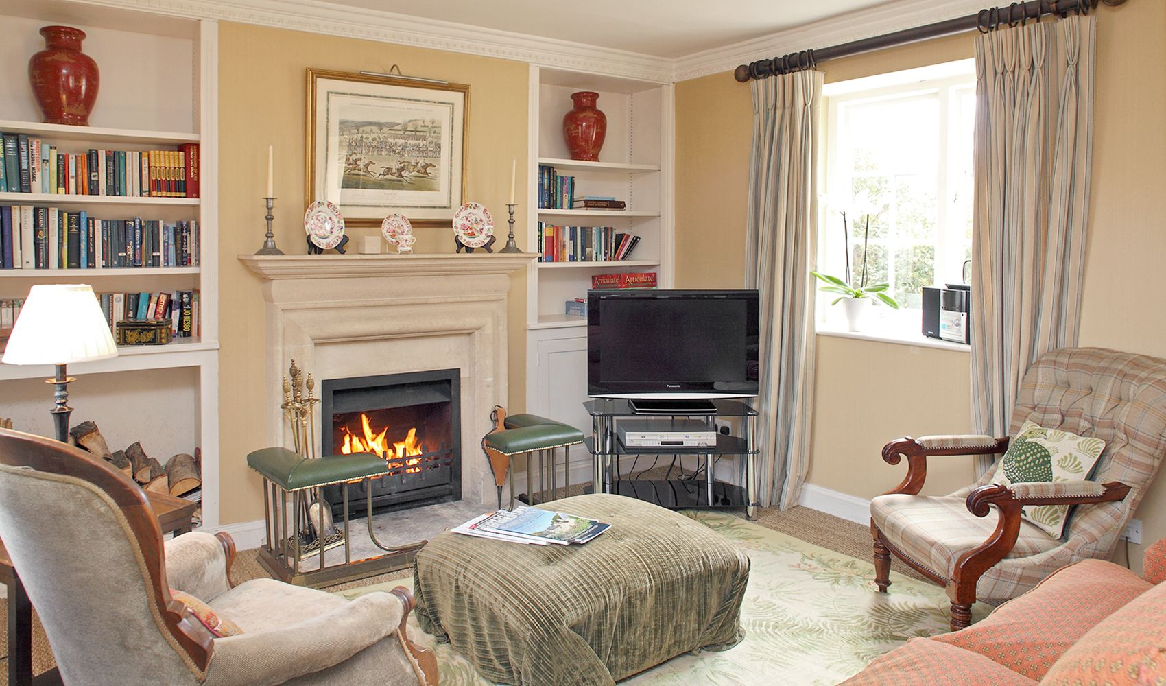 Ground floor: Cosy drawing room with open fire in a stone fireplace