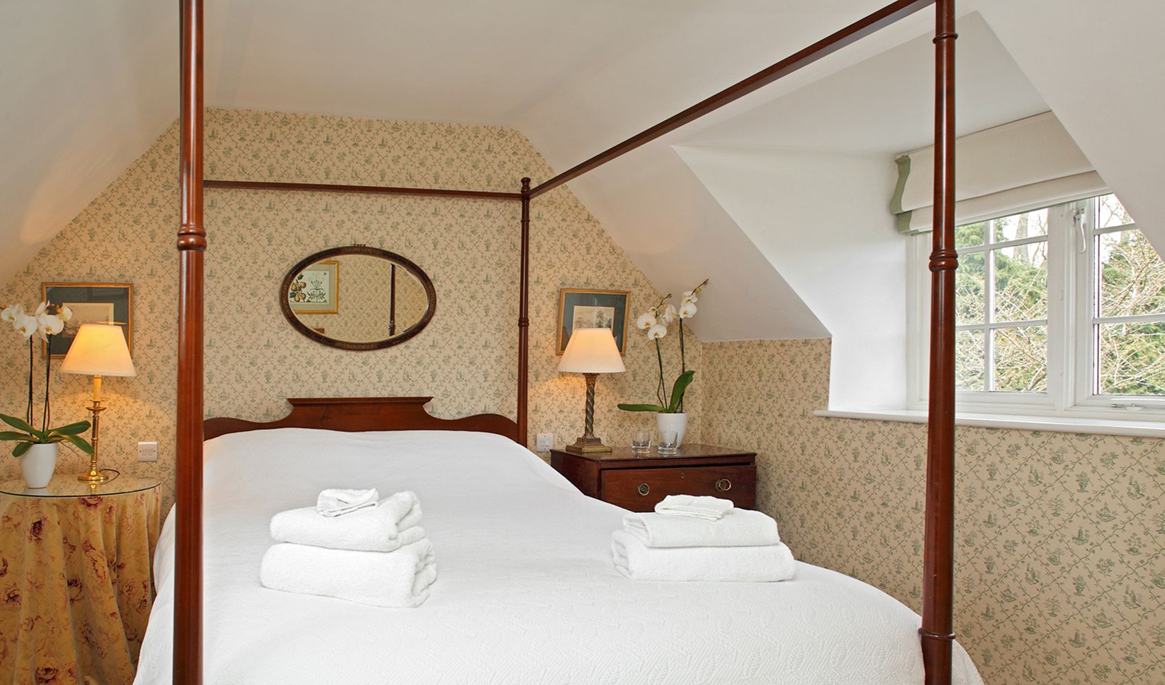 First floor: Double bedroom with mahogany four poster bed & en suite shower