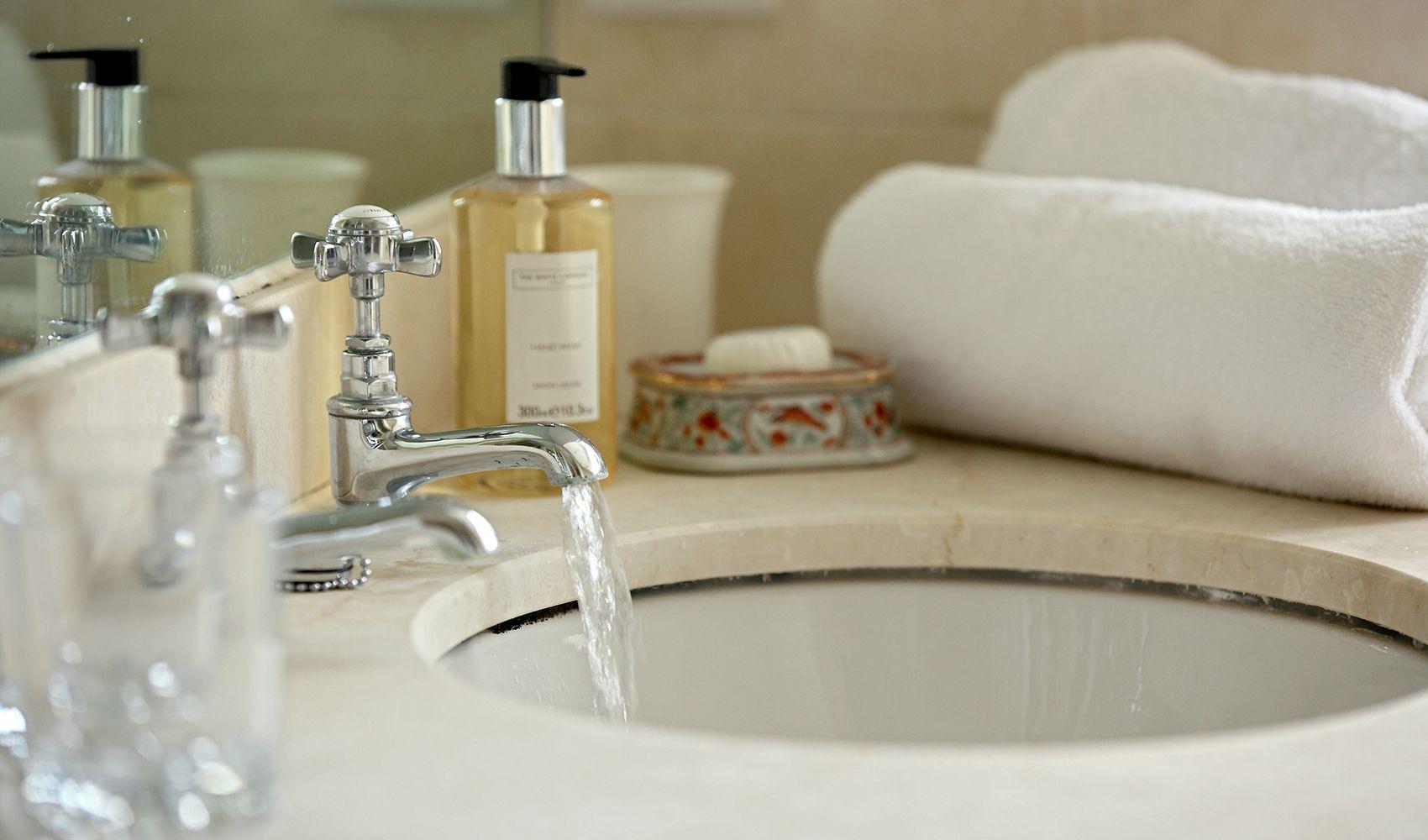 First floor: Marble washstand in en suite shower room to double bedroom