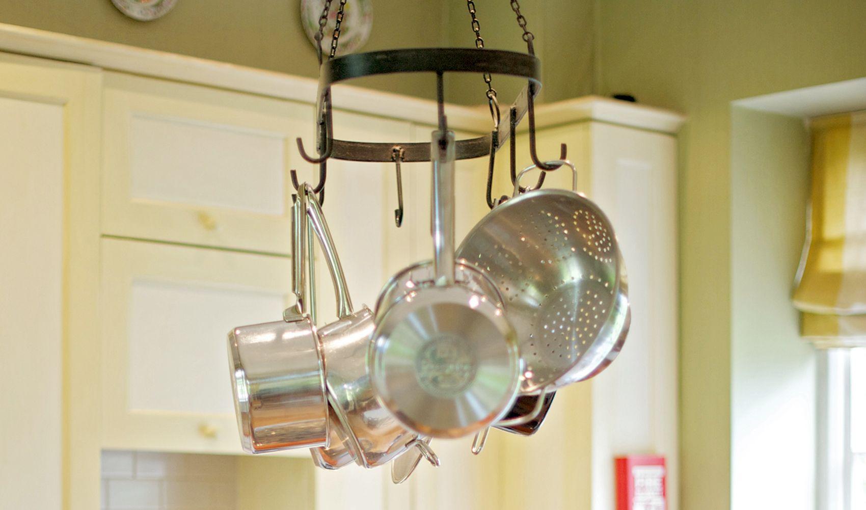 Ground floor: Wrought iron rack for saucepans and utensils above kitchen island