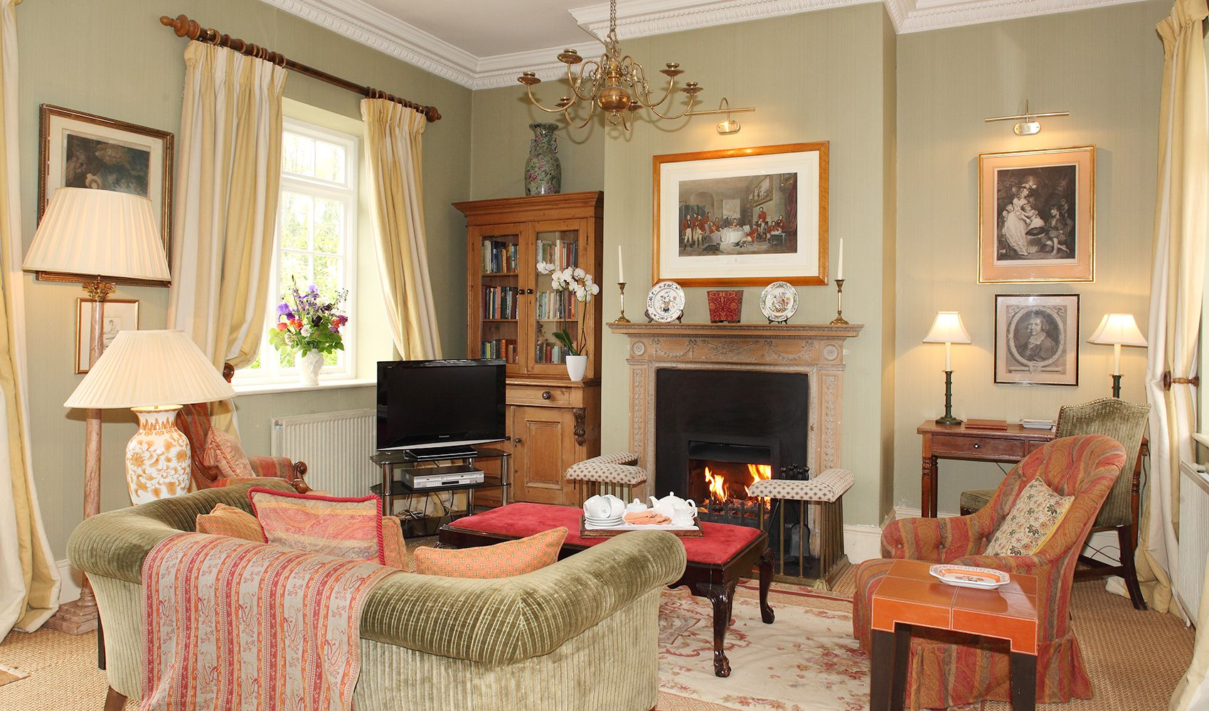 Ground floor: Drawing room in the open plan living area with an open fire