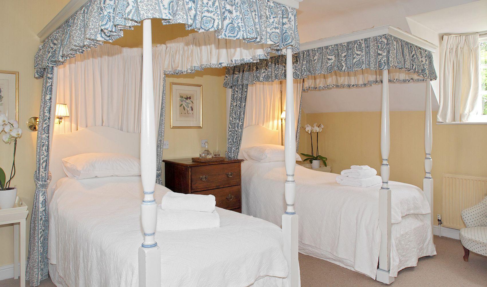 First floor: Twin bedroom with four poster beds & en suite wet room