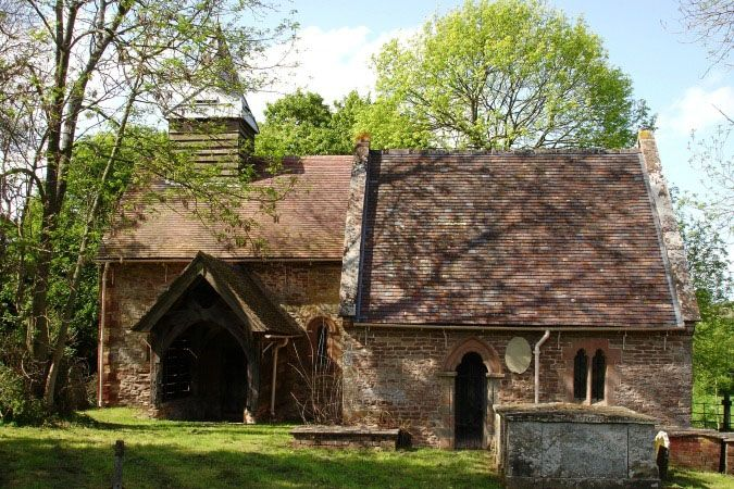 Next to Upton Cressett Hall is the historic Norman church of St Michael's with its 12th century wall paintings