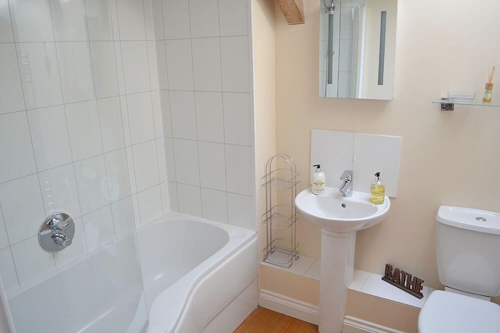 First floor: Family bathroom with a P shaped bath with shower over