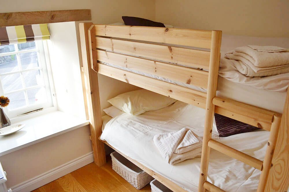 First floor: Bedroom with 3' bunk beds