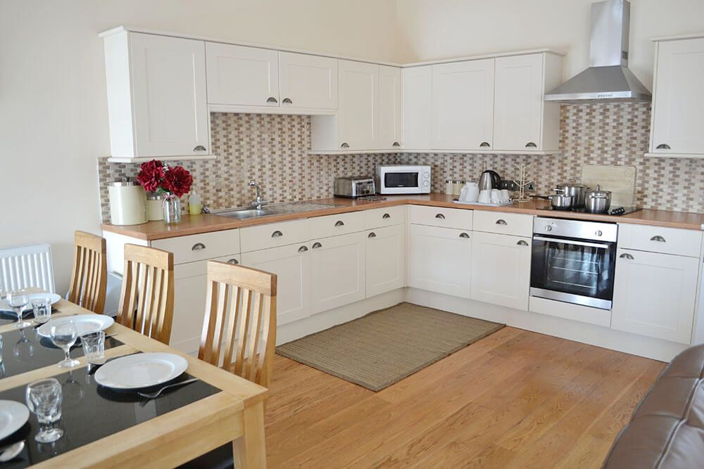 Ground floor modern fitted kitchen area in the spacious open plan living space