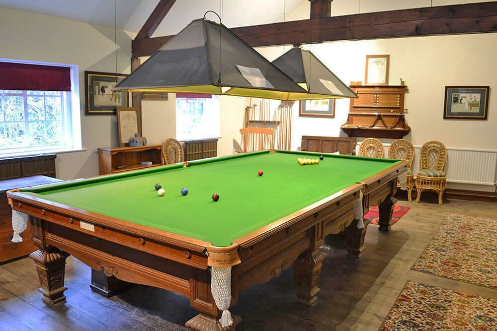 Shared games room with pool table