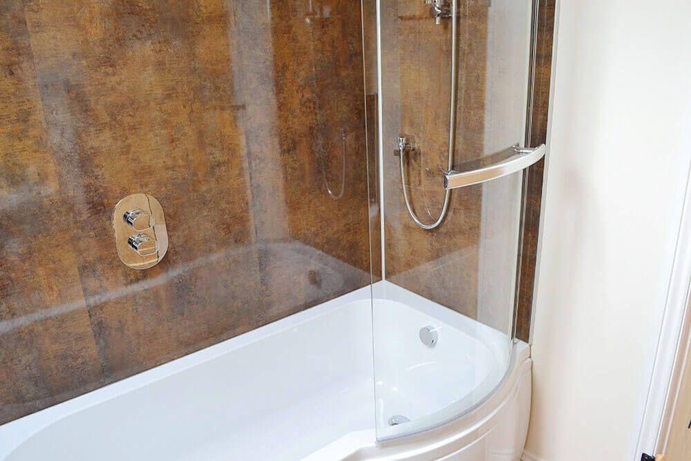 First floor: Family bathroom with a shower over the bath