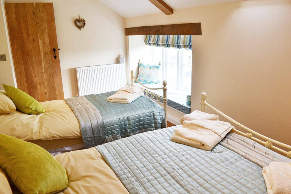 First floor: Triple bedroom with 5' double bed and a 3' single bed