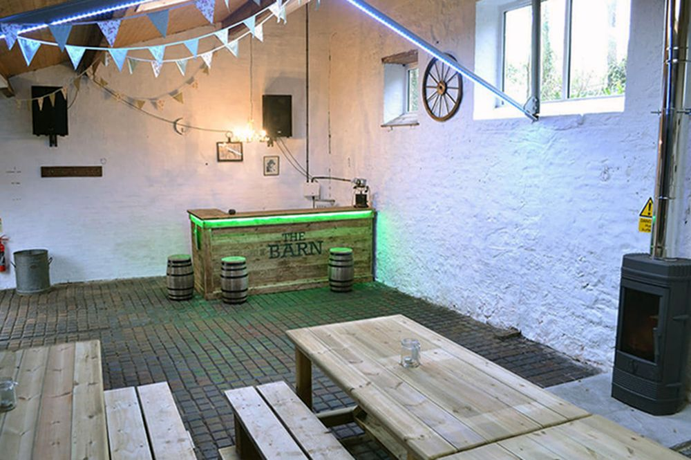 A rustic party barn is available for hire when booking several cottages together, with bar, seating for 30, wood burner & sound system