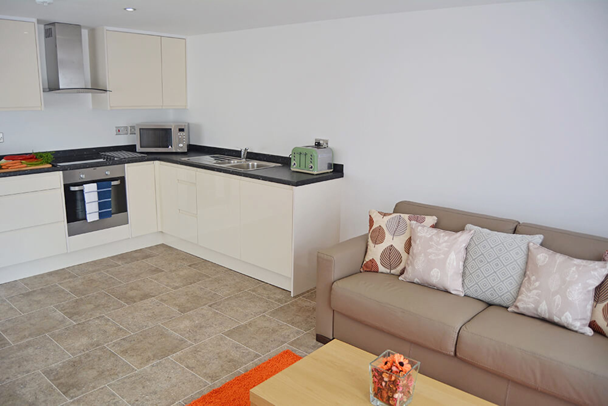 Spacious open plan living space comprising a sitting, dining and modern fitted kitchen