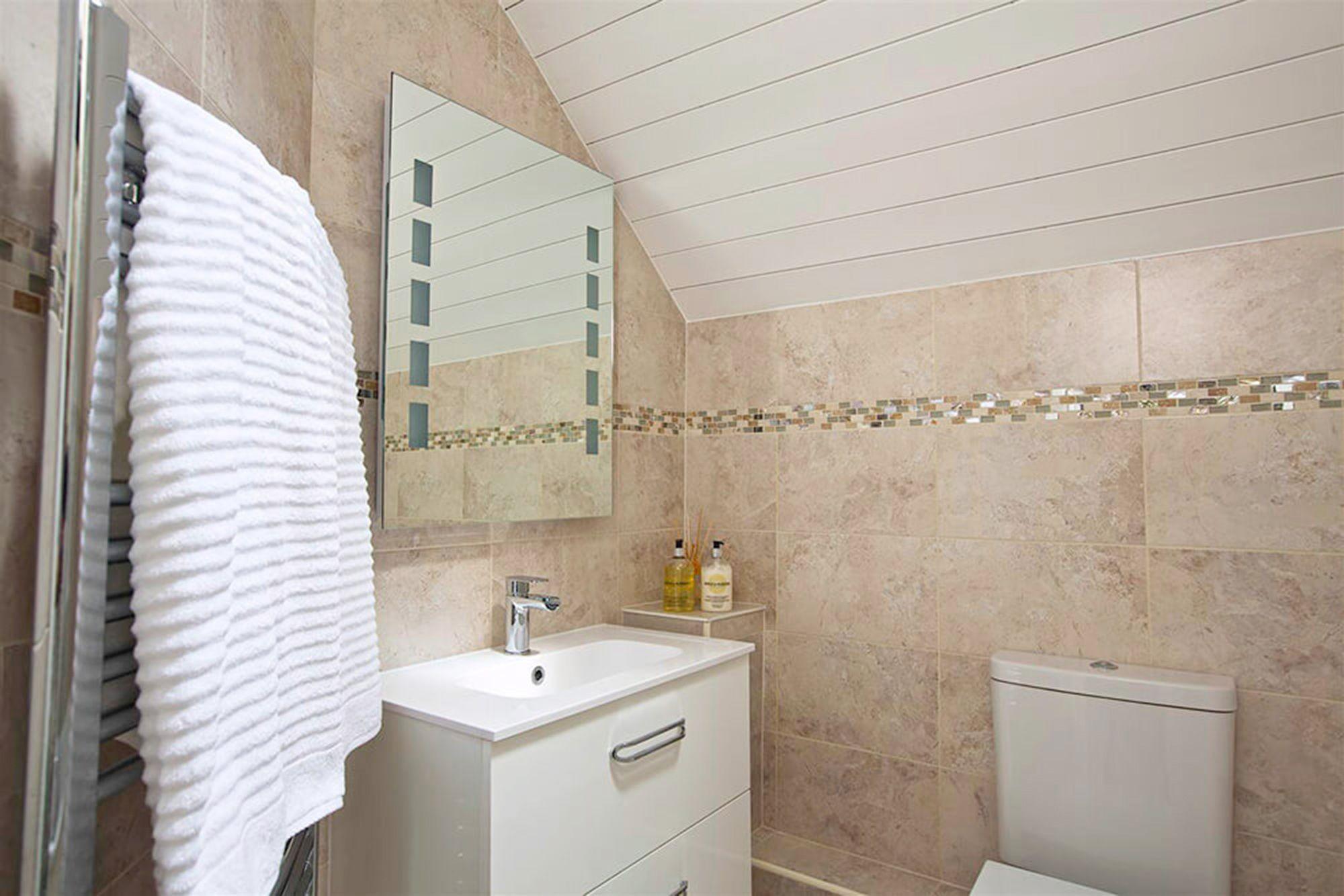 First floor: Family bathroom with a bath and overhead shower