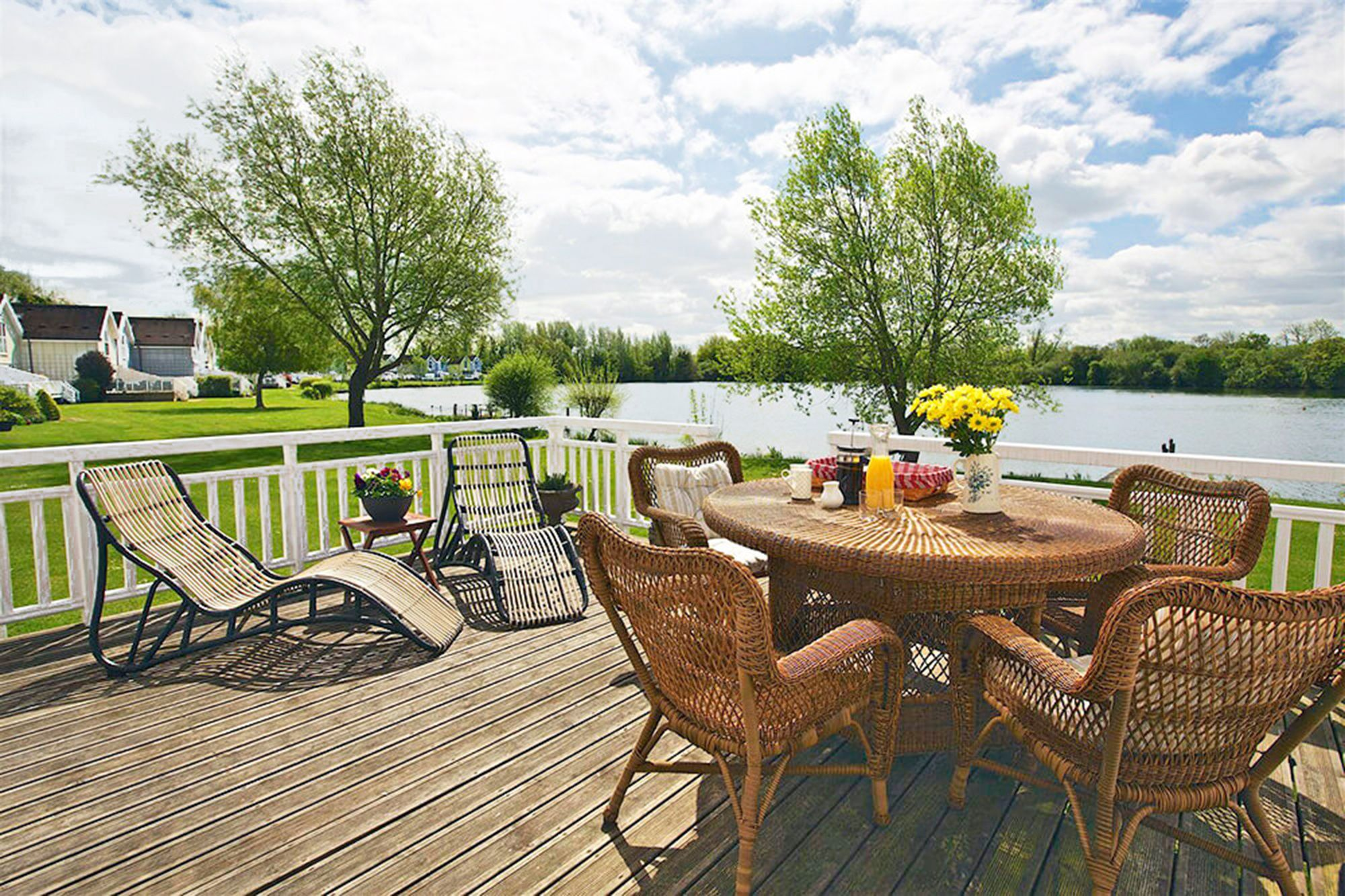 Private secure deck onto the lake with table and chairs and a barbecue