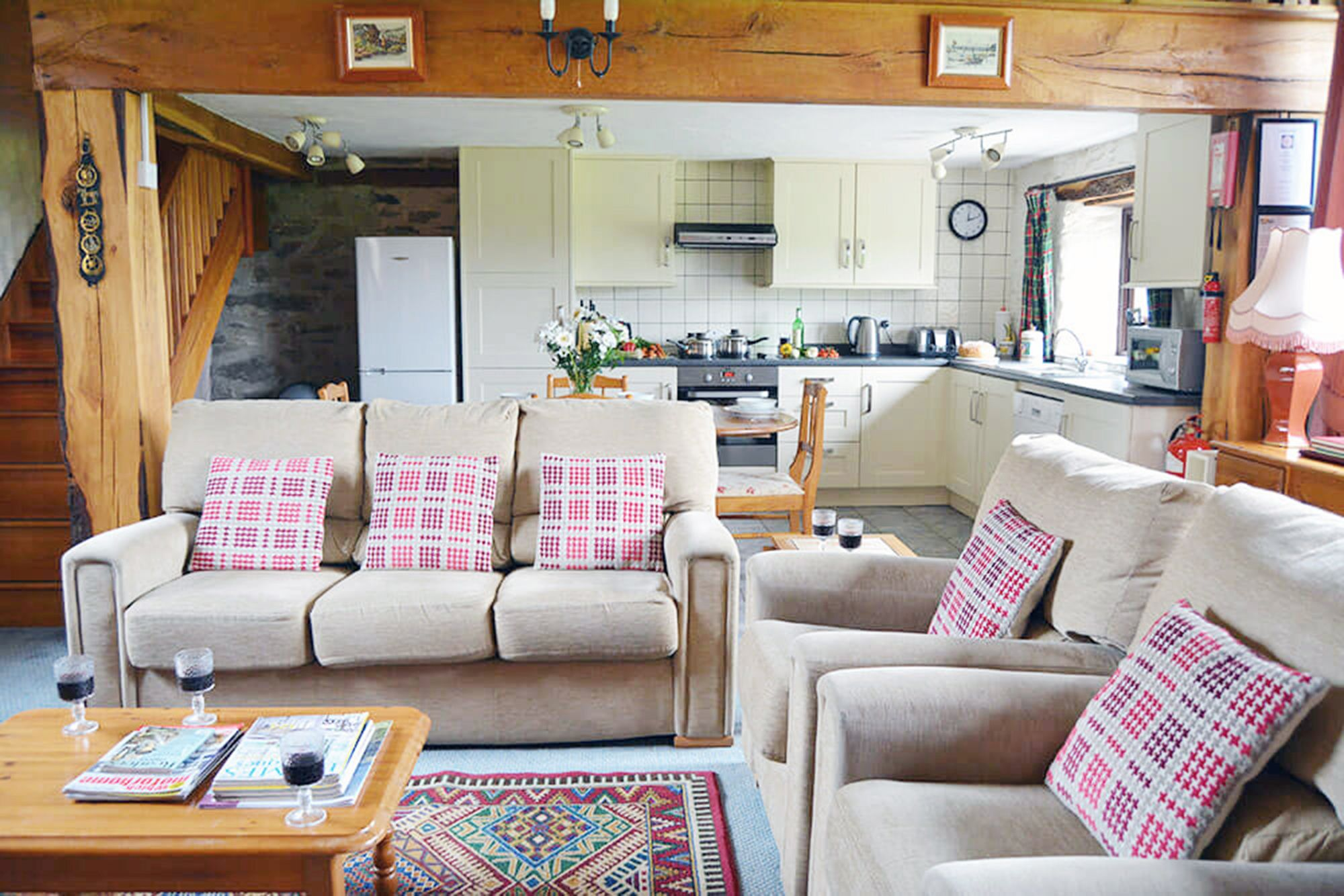 Kiri Cottage ground floor: Spacious open plan living space comprising a sitting area, dining area and fitted kitchen area