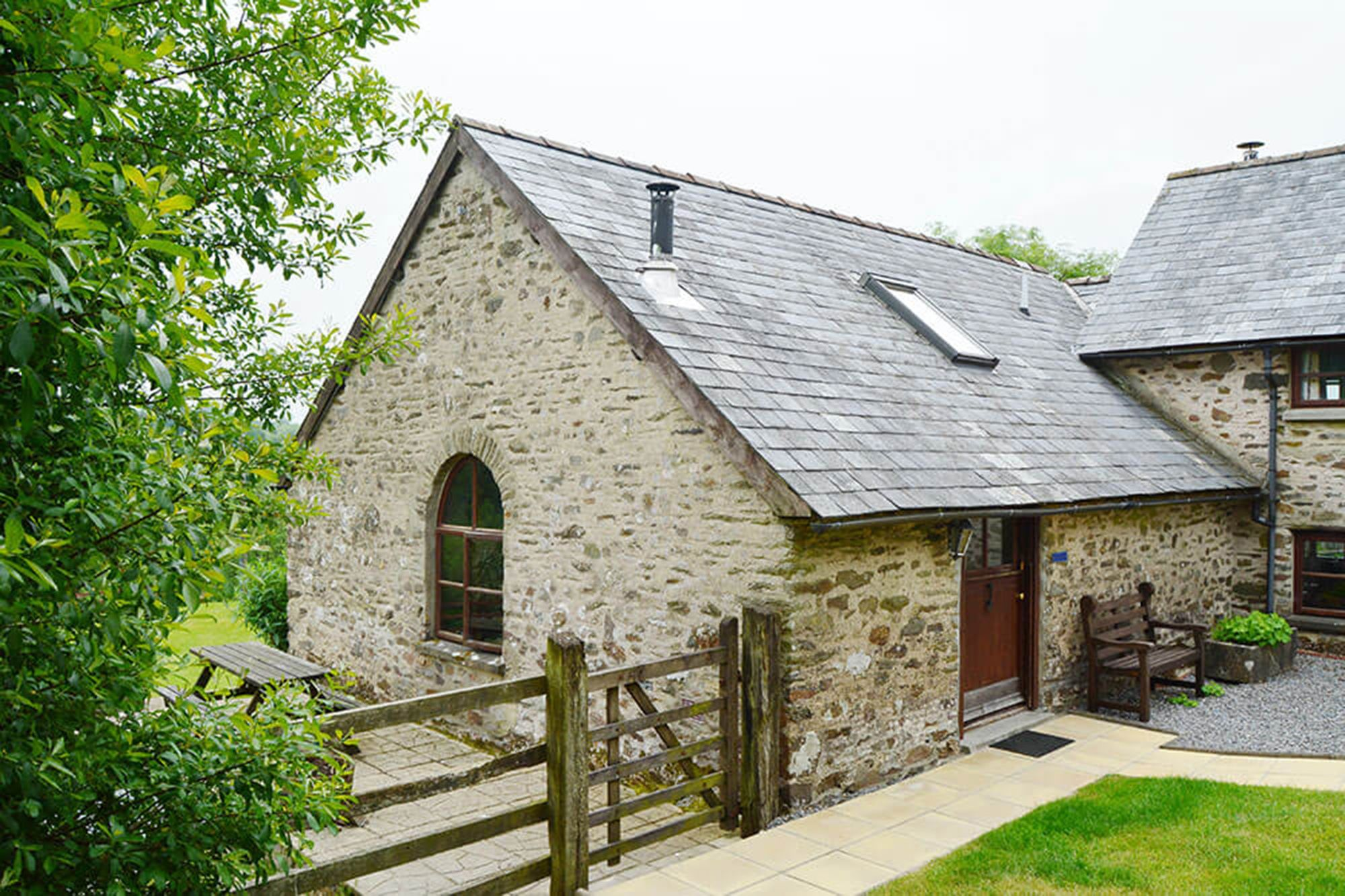 Smiddy Cottage is tucked around the corner, abutting the rear of Kiri Cottage