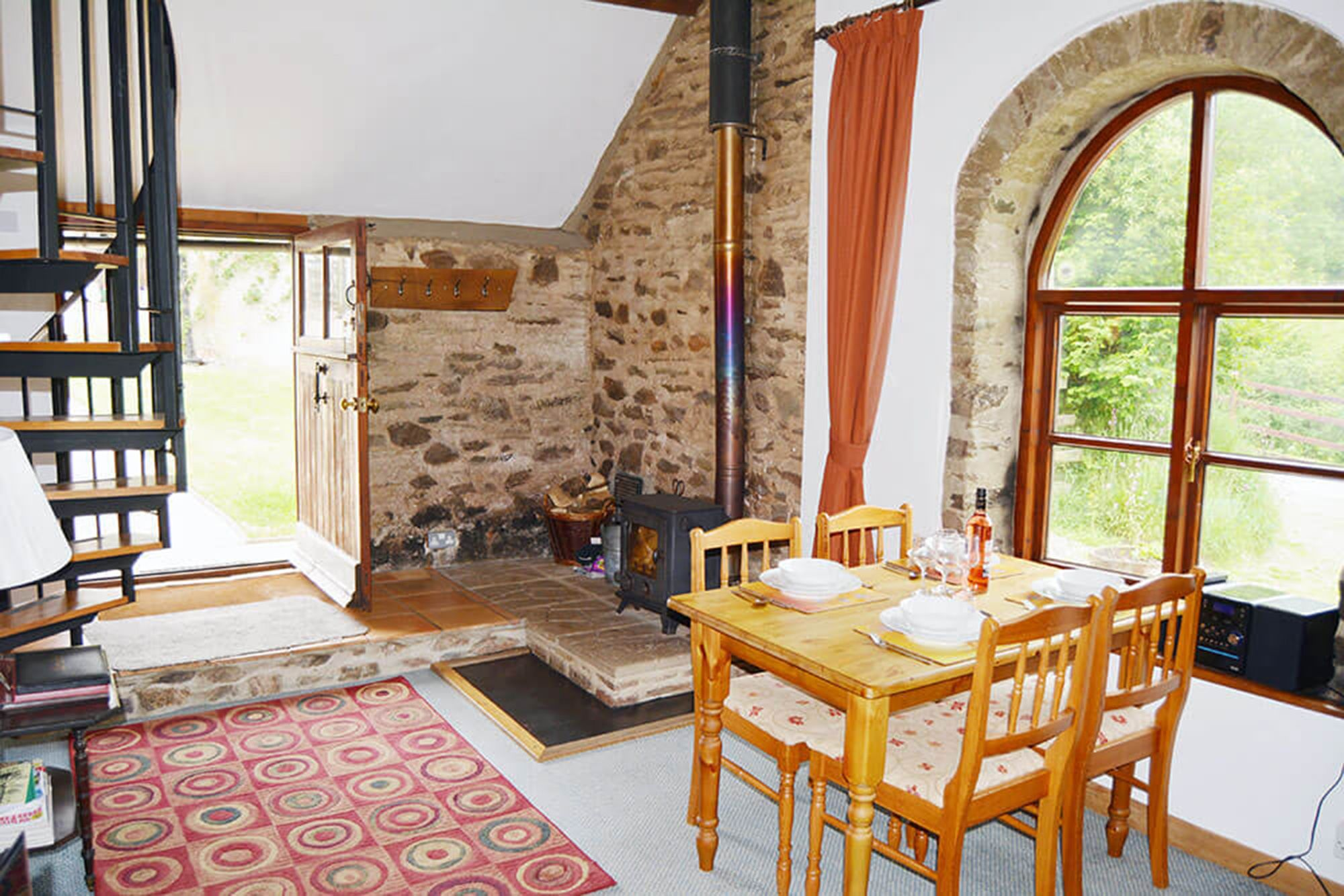 Smiddy ground floor: Dining area in the spacious open plan living space with wood burning stove