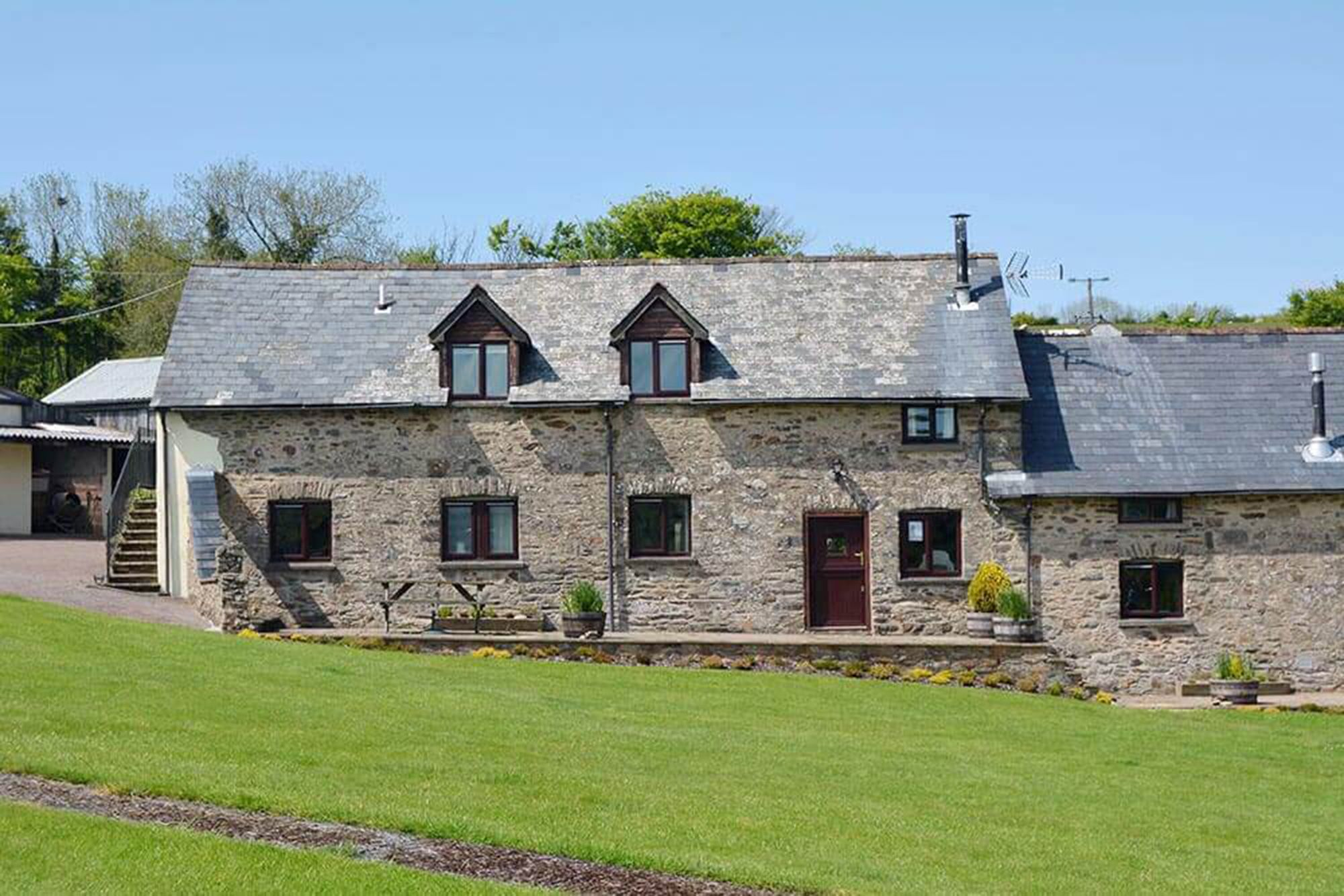 Jasper Cottage, sleeping 4, is a traditional stone barn conversion with a private patio area and garden furniture