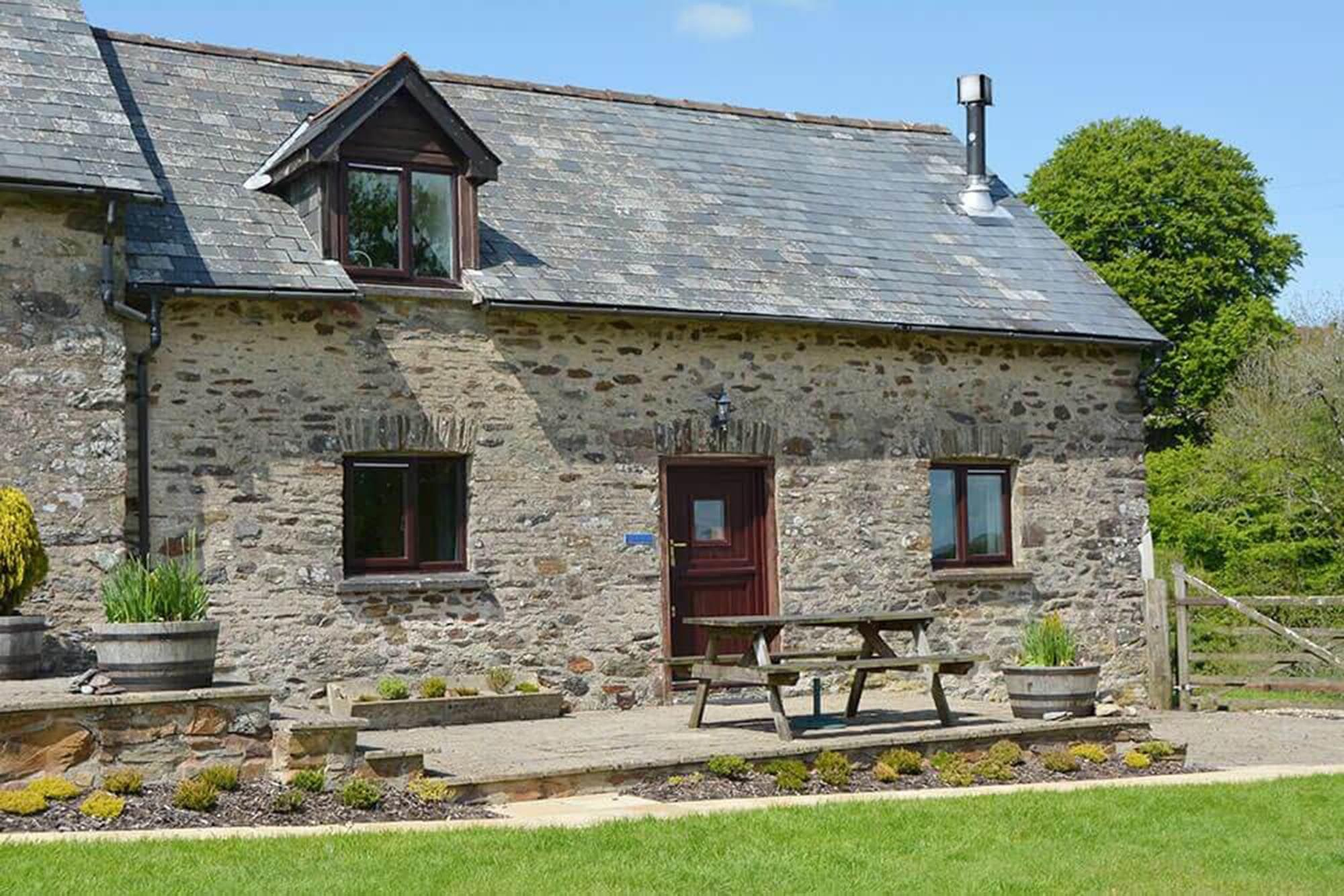 Norton Cottage, sleeping 4, is a traditional stone barn conversion with a private patio area and garden furniture