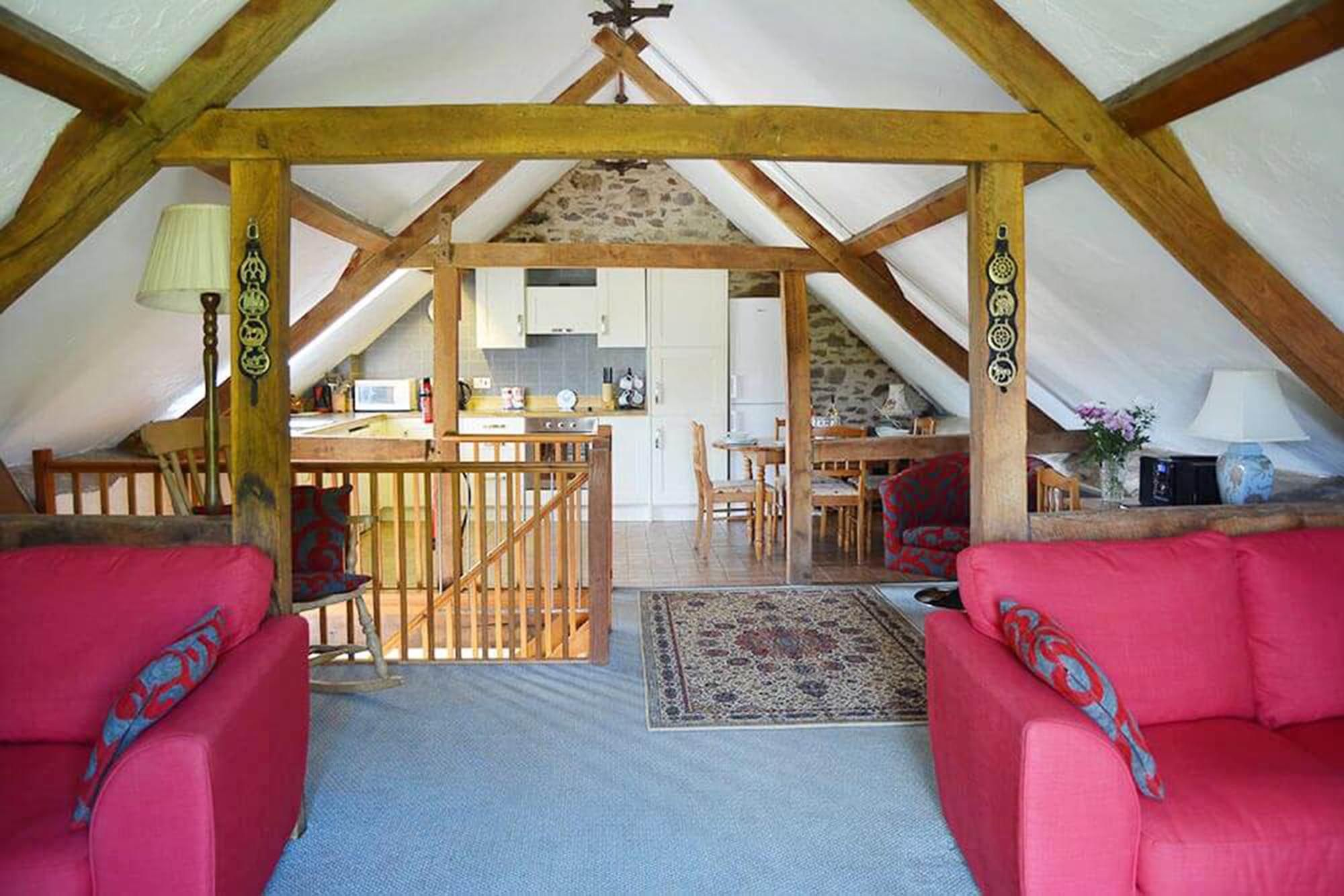 Norton Cottage first floor: Open plan living space from the sitting area with superb views across the lawn and moorland beyond