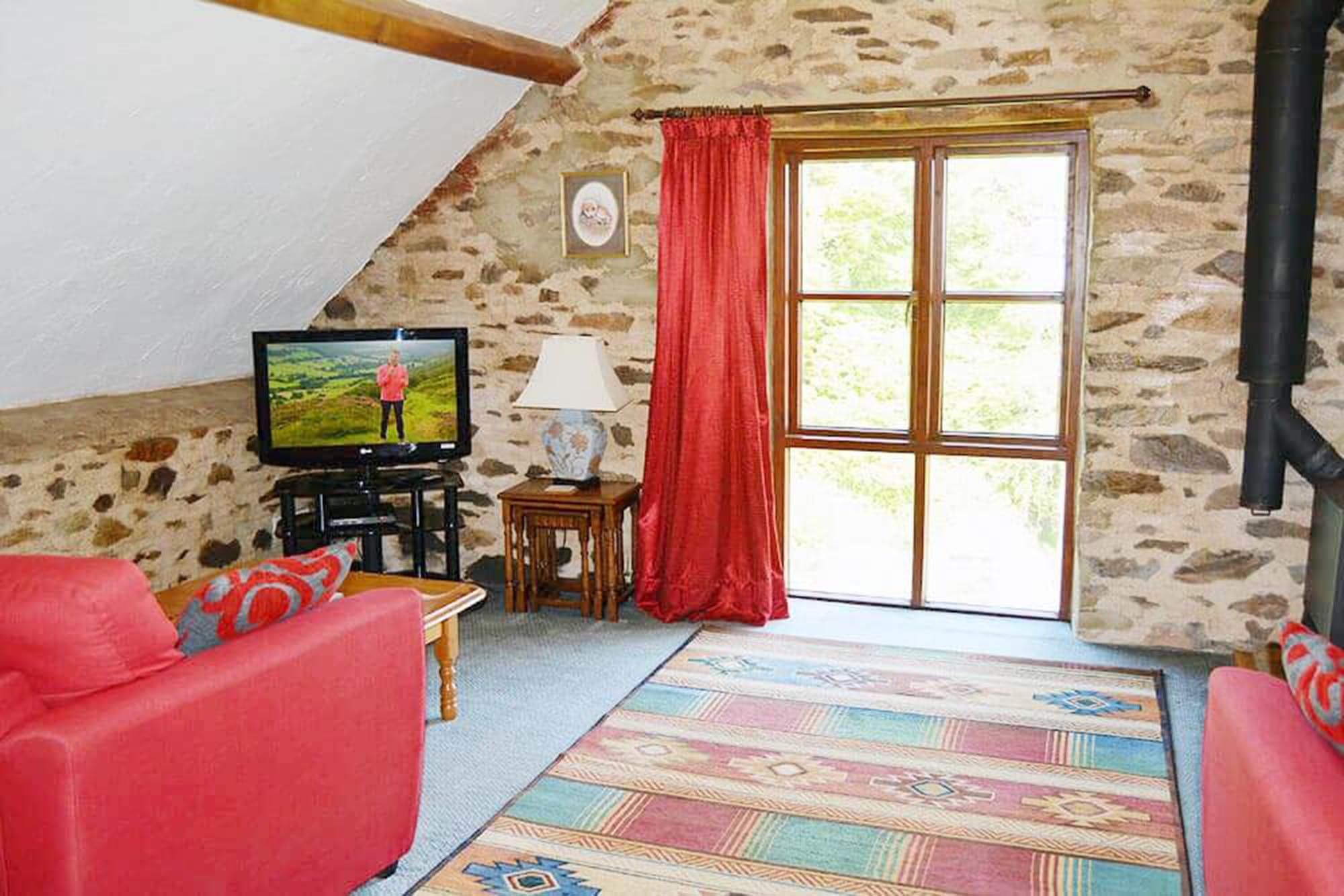 Norton Cottage first floor: Sitting area in the open plan living space with superb views